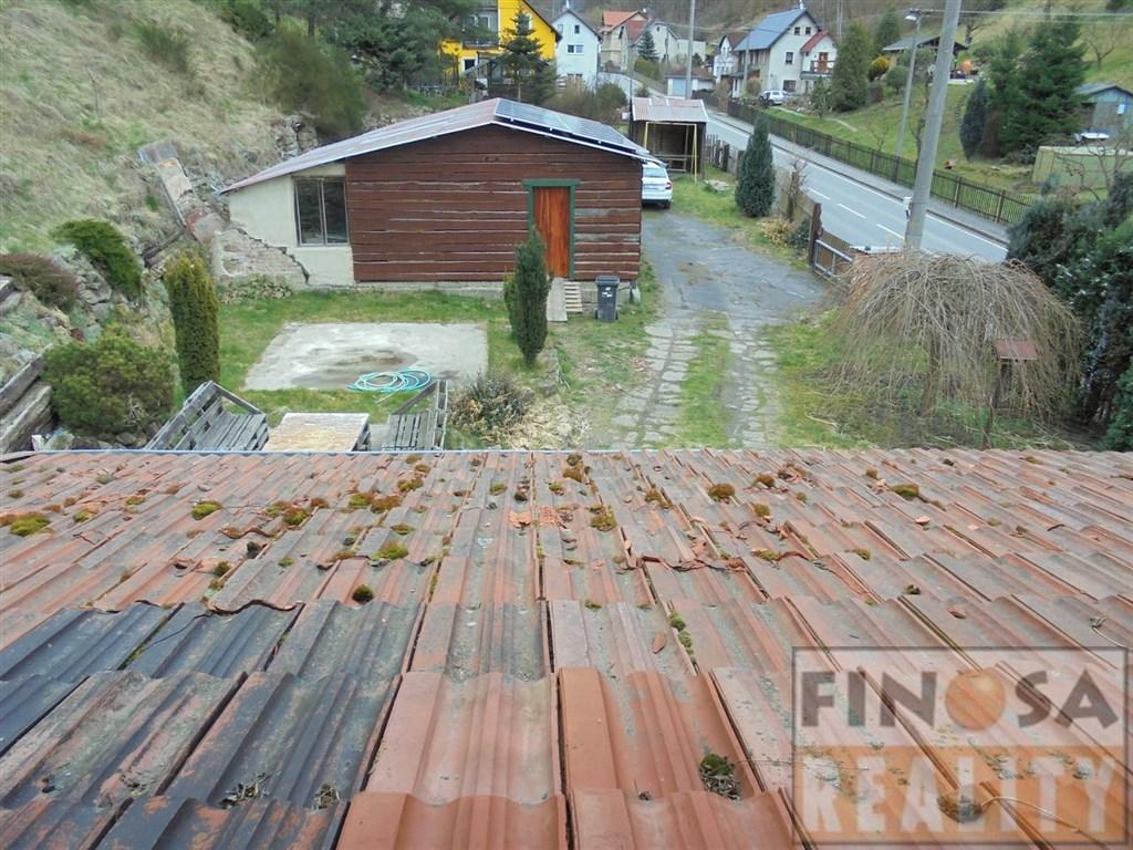Na prodej samostatně stojící rodinný dům 3+kk se zahradou a dílnou v obci Ludvíkovice, okr. Děčín.
