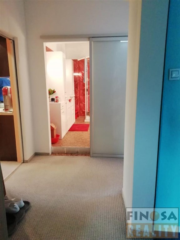 Na prodej prostorný podkrovní byt 3+kk v žádané lokalitě Děčína.